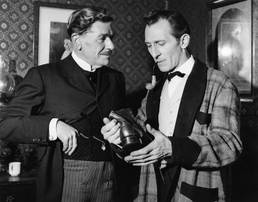 English actor Peter Cushing as fictional detective Sherlock Holmes with Andre Morell as Dr Watson in a scene from 'The Hound of the Baskervilles', 1959. (Photo by Express Newspapers Gett